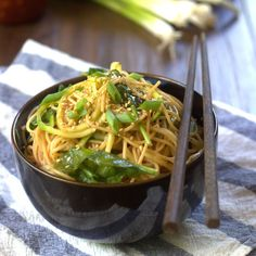 A balanced blend of pasta and spiralized zucchini noodles are tossed in a garlicky sesame dressing and served with tender baby spinach in this light and flavorful summer meal.