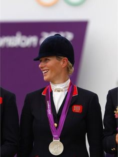 Zara Phillips riding High Kingdom poses with her silver medal
