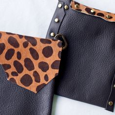 Black & Cheetah Holdster~Inspired by the queen huntress herself, our faux Cheetah is a natural beauty. Set against a black leather pocket, she is sure to be seen.   #holdster #handsfreepurse #fashionpurse #crossbody #leatherpurse #handmade #minimaliststyle #travelpurse #gypsystyle #bohostyle #blackpurse #cheetahstyle #fannypack #securepurse #concertpurse #festivalpurse #adjustablepurse