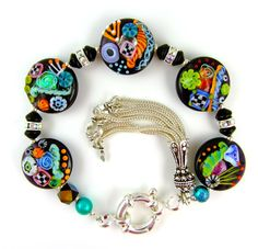 Love these lampwork beads by Corinabeads.