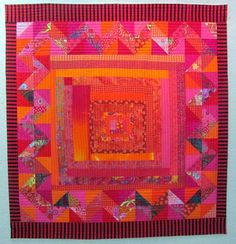 Melody's fabulous red/pink/orange quilt. The border makes everything - especially some of the darker prints on the bottom to give it weight.