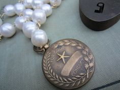 Vintage recycled repurposed good conduct medal on wire wrapped pearl necklace