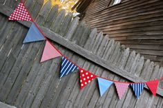 Nautical Birthday Party Bunting in red, navy blue, white fabric, via Etsy.