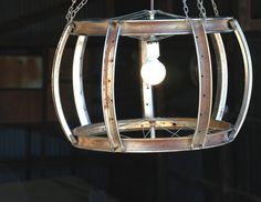 I LOVE LOVE THIS!!!    Unique, upcycled chandelier type light fixture made from reclaimed bike rims.