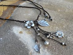 THIS IS FINE!!!!!!      Sterling Silver  Macrame Chocolate Leather Flower Charm Long Necklace Adjustable. $125.00, via Etsy.