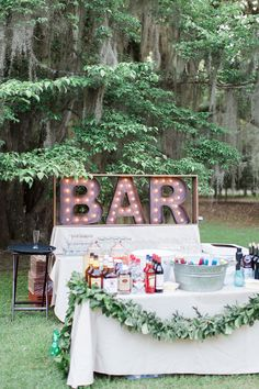 Hate the letters, but like the garland to dress up a very simple bar