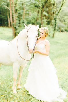 a white horse should always be a must at any wedding! don't you think? http://www.weddingchicks.com/2013/10/18/colorful-garden-wedding-ideas-2/