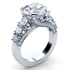 #204 This stunning engagement ring features a round brilliant cut diamond at the top of a criss-cross white gold shank, accented by prong and bright cut set diamonds lined with milgrain. It's a...