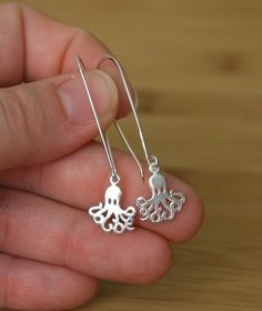 I'm questing for just-the-right style of octopus jewelry...these come close, but I wish they were a necklace.