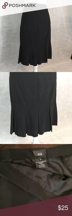 Black skirt with kick pleats Black skirt with kick pleats. Appropriate for work or play. Smoke free home. AGB Skirts Midi