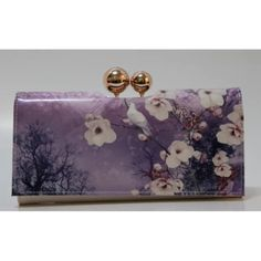 """Ted Baker London Misty Mountains Odd Ball Matinee Ted Baker London Misty Mountains Odd Ball Matinee Wallet  100% Authentic  Color: Mid Blue Style: XA5W/XLA1/ARIANA Retail: $135.00  Kiss-lock clasp closure. Exterior zip pocket. Snap-flap exterior compartment with interior currency and slip pockets; 11 card slots; ID window. Interior slip pockets. Signature floral-print lining. Leather. By Ted Baker London; imported. 7  1/2 """"W x 3  1/2 """"H x 1""""D. Ted Baker Bags Wallets"""