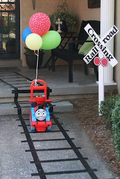 * Train Theme Party using black tape for railway tracks.