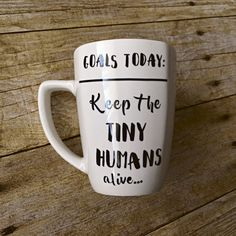 Goals Today: Keep the tiny humans alive ceramic mug. Our best selling mug is even better now with the design printed on both sides of the mug to show off your exhaustion to everyone. This is the perfect gift for the exhausted mom in your life. We all know how hard momming can be! Also a great gift for teachers, daycare providers, pediatric nurses, and more!  Dishwasher safe!