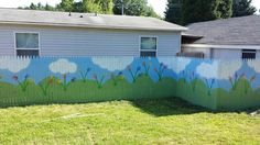The mural we created on the fence in the backyard... Each 'flower'  is one of our hand prints