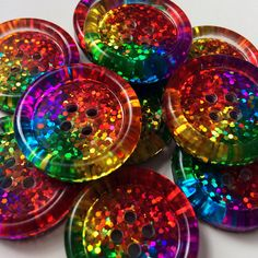 These bright, chunky rainbow spangle buttons have been my best seller for four years now. These rainbow wheel patterned buttons, along with their striped sisters are the perfect addition to jazz up that dreary old cardigan, add as a unique focal point and finishing touch to any of