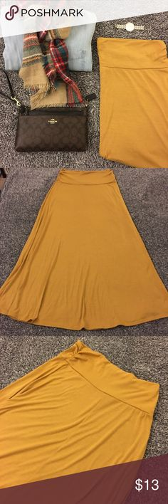 Mustard yellow maxi skirt! Comfy & cute! A comfy staple that can be dressed up or worn as casual. Pre loved but in good used shape. Only minor pulling with the possible minimal stain, but nothing obvious upon my checking b4 listing. Not new but still tons of life and use left to it and looks great! Smoke free home. Waist is 15 inches laid flat with extra stretch due to the knit fabric. Hips are roughly 18.5 with a line style. Length is right at about 39.5 inches. Questions? Ask…