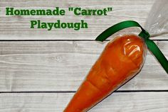 """Make this easy DIY Homemade Playdough """"Carrot"""". Perfect to celebrate spring or to add to your Easter basket!"""