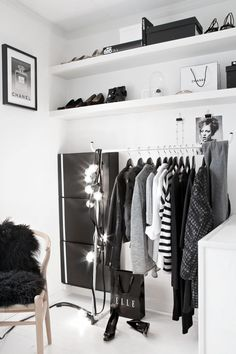 In my place I would have a set up like this and place all my outfits for the following week on the rail and in an enclosed wardrobe have alllllllll my other clothes.