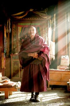 Tibetan monk in the sunlight Visit us adventuretravelshop.co.uk for amazing holidays in Asia with leading adventure travel companies.