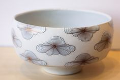 A dreamy serving bowl by local Michigan artist, Andrew Gilliat. Come in to the Gallery Shop today to see other whimsical pieces by Andrew! ($150)