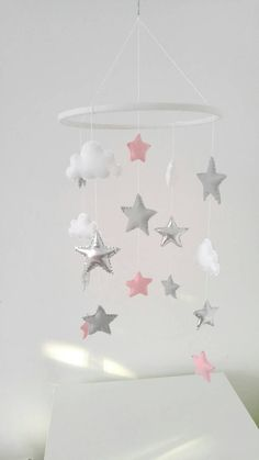 Check out this item in my Etsy shop https://www.etsy.com/uk/listing/490380067/stars-and-clouds-nursery-mobile-baby