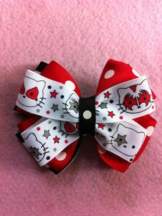 9949e9e438 Items similar to Kiss Hello Kitty Hair Bow on Etsy