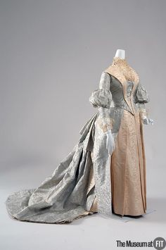 Dress Made Of Aqua Silk Jacquard, Cream Silk Moire' Taffeta And Patterned Silk Net - Designed By M.A. O'Connell - American   c.1887  -  The Museum at FIT