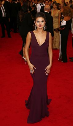 Selena Gomez looked amazing in a formal floor-length Diane Von Furstenberg gown for the 2014 Met Ball. Complete with a ruffled deep V and even a flowing train for an extra pop of elegance, Selena stunned in her plum outfit. Paired with old-Hollywood earrings and classic makeup.