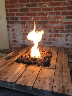 Gas Fire Pit built into a pallet table. Pallet Projects. DIY fire pit.