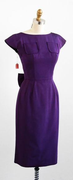 vintage 1960s purple deadstock wiggle dress with enormous bow + rhinestone buttons up the back.