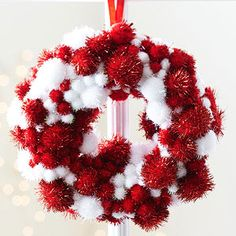 Mini Pom-Pom Wreath Ornament can be used on your tree or made into a pretty garland.