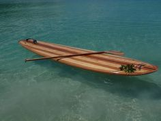 Hand made wooden strip stand up paddleboard. Gorgeous, but guessing wicked heavy too!