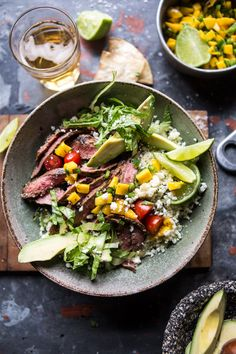 The perfect Monday Bowl: Cauliflower Rice Carne Asada Bowl! The post Cauliflower Rice Carne Asada Bowls with Mango Salsa. appeared first on Half Baked Harvest. Mexican Food Recipes, Beef Recipes, Dinner Recipes, Healthy Recipes, Ethnic Recipes, Quick Recipes, Recipies, Clean Eating, Healthy Eating