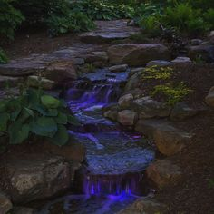 Color Changing SOL LED Lighting from Atlantic Water Gardens Backyard Water Feature, Ponds Backyard, Backyard Waterfalls, Backyard Lighting, Outdoor Lighting, Large Water Features, Waterfall Lights, Small Fountains, Waterfall Design
