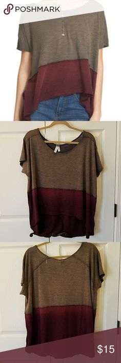 We the Free Midnight Color Block Tee EUC Super cute top!  I bought this, took off tags and hung in closet.  I wore it for a few hours the other night and it is a bit big on me.  I have ordered the xs.  No flaws. Free People Tops