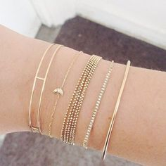 love the simplicity of the gold bracelets