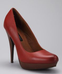 Take a look at this Orange Emily Pump by Calvin Klein on #zulily today! $34.99, regular 89.00.  PRODUCT DESCRIPTION: Fashioned from smooth leather, this pump merges feminine and sophisticated styles. The stacked heel and platform offer a leg-lengthening lift.   4.5'' heel with 1'' platform Leather upper Man-made sole Imported