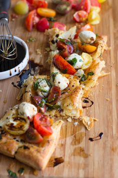 Heriloom tomatoes, puff pastry, marinated mozzarella and balsamic reduction and guess what, all of it is premade and you can whip it all together.