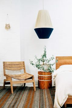 two-tone pendant lamp with natural wood furnishings