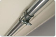 Make your own extra long curtain rod on the cheap with conduit pipes!