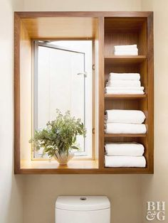 If your bathroom has an existing feature above the toilet—like this room's charming window—build your storage solution around it. Walnut casework spruces up the area and adds bountiful space to stash bath linens. When adding casework, be prepared to shell Over Toilet Storage, Shelves Over Toilet, Small Bathroom Storage, Laundry Room Organization, Bathroom Shelves, Bathroom Flooring, Bathroom Furniture, Laundry Rooms, Cabinet Above Toilet
