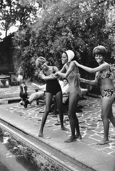 Diana Ross and The Supremes playing around poolside...