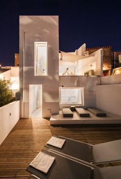 """The backside of the house from the """"garden"""" level terrace. The interior and exterior lighting plan has been designed to evoke a feeling of intimacy"""