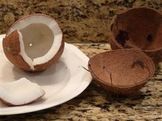 how to open a coconut-Genius!!! Heat it in the oven! And it pops right out of the shell!