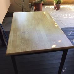 Selling one used kitchen / dining room table. Light wood table top with very dark green legs. Legs are detachable. Table is in a used condition, the table top is not perfect as we have tried to show in the pictures but in a very useable condition. Could easily be sanded down  lightly and waxed / polished / varnished. Measures  122 L / 77 W / 75 H all in cm. buyer collects from Simei or can deliver within Singapore at cost to buyer for petrol.