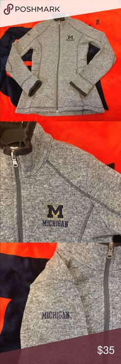 U of M women's zip up sweater University of Michigan women's zip up sweater with a soft fur like lining on the inside of the sleeves (wrist area) and the inside of the collar. It's also in the pockets! 😍 Size Small. This item will fit to your body figure and looks awesome. I liked mine so much I bought a second one but I just never wear the second one so it's available for you guys! It's super warm and fits under jackets. Sleeves are also long enough for me and I have long arms 😂 Champion…