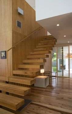 I love the chunkiness of these floating steps, and how prominent the beautiful woodgrain is.