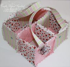 Rag quilt carrying bag with compartments.