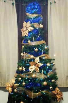 add poinsettias and ribbon for an extra decorative touch silver christmas tree christmas tree - Blue And Gold Christmas Decorations