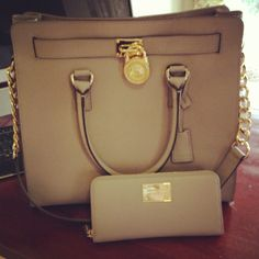 gorgeous Michael Kors wallet and purse....mine is in black but the smaller version and a brown wallet! Love! :)